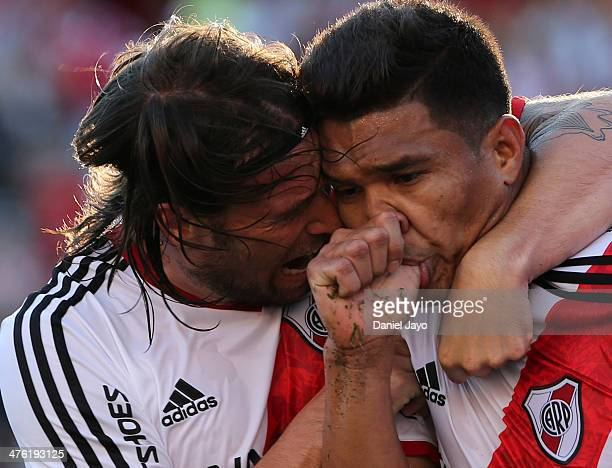 Teofilo Gutierrez of River Plate celebrates with teammate Fernando Cavenaghi after scoring during a match between River Plate and San Lorenzo as part...