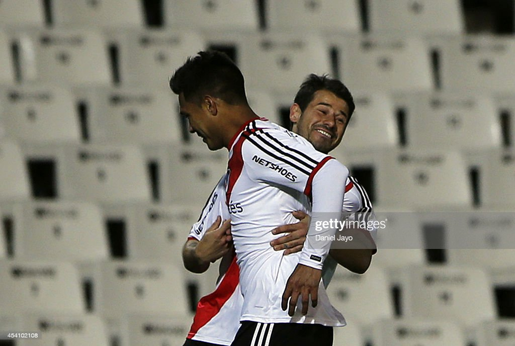 Teofilo Gutierrez of River Plate celebrates with teammate Rodrigo Mora after scoring during a match between Godoy Cruz and River Plate as part of...