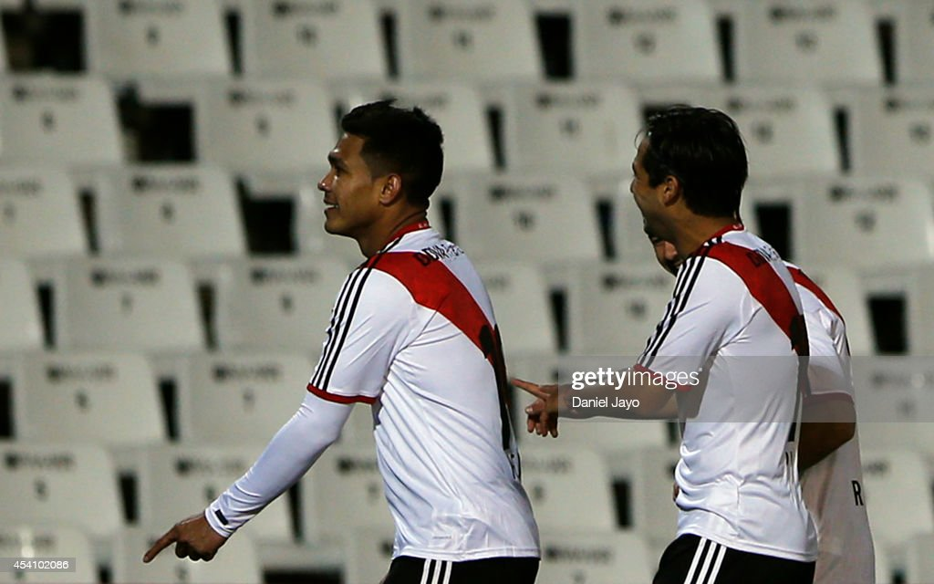 Teofilo Gutierrez of River Plate celebrates with teammates after scoring during a match between Godoy Cruz and River Plate as part of third round of...