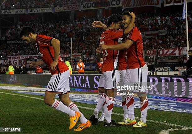 Teofilo Gutierrez of River Plate celebrates with teammates after scoring the opening goal during a match between River Plate and Rosario Central as...