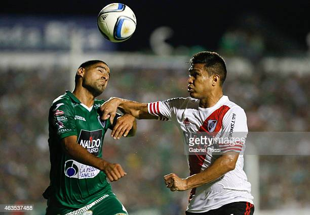 Teofilo Gutierrez of River Plate fights for the ball with Pablo Aguilar of Sarmiento during a match between Sarmiento and River Plate as part of...