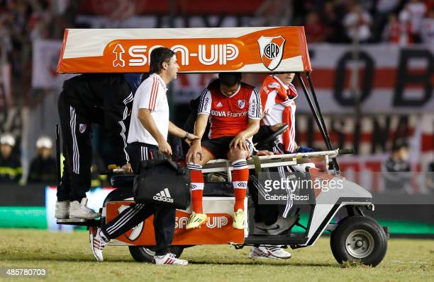 Teofilo Gutierrez of River Plate leaves the field injured during a match between River Plate and Velez Sarsfield as part of 15th round of Torneo...