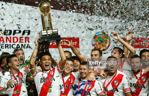 Teofilo Gutierrez of River Plate raises the trophy as he celebrates with his teammates after winning a second leg match between San Lorenzo and River...