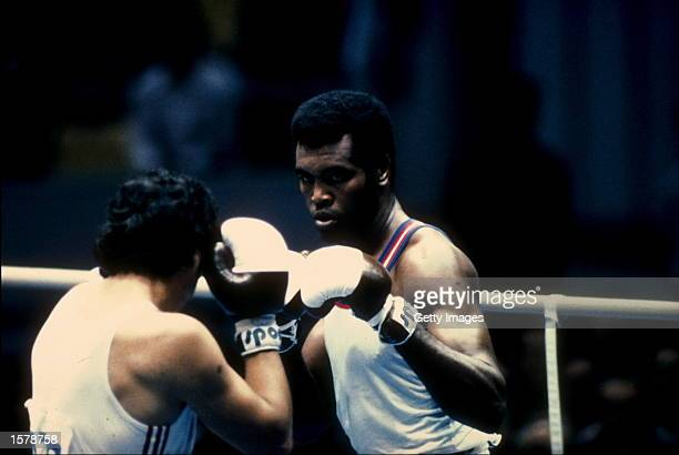 Teofilo Stevenson of Cuba focuses intently on his opponent during a heavy weight bout in the 1980 Summer Olympic Games held in Moscow USSR Stevenson...