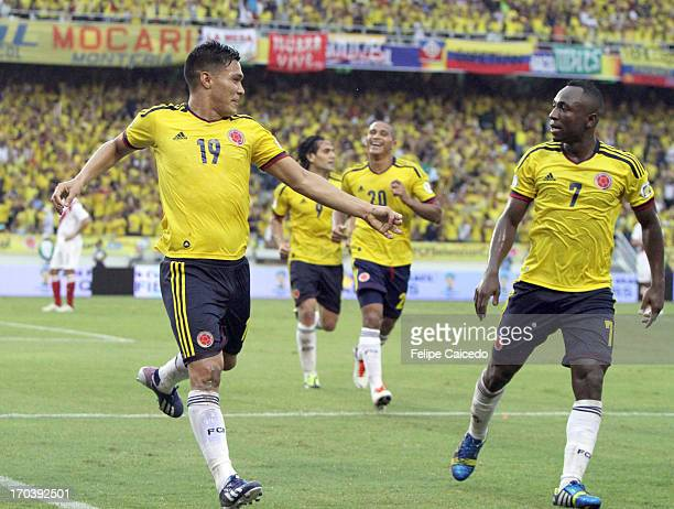 Teolfilo Gutierrez of Colombia celebrates a goal with his teammates during a match between Colombia and Peru as part of the South American Qualifiers...