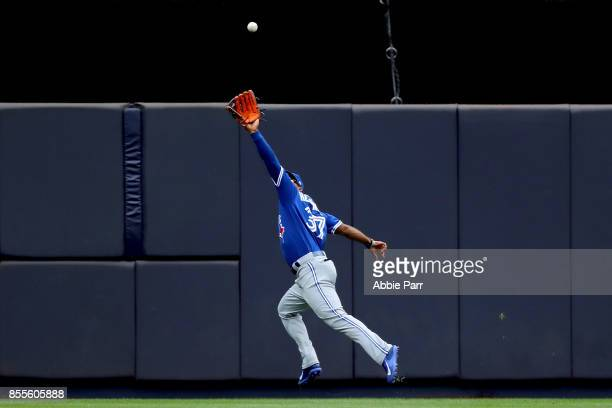 Teoscar Hernandez of the Toronto Blue Jays catches a fly out against the New York Yankees at Yankee Stadium on September 29 2017 in the Bronx borough...