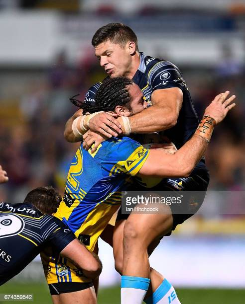 Tepai Moeroa of the Eels is tackled high by Corey Jensen of the Cowboys during the round nine NRL match between the North Queensland Cowboys and the...