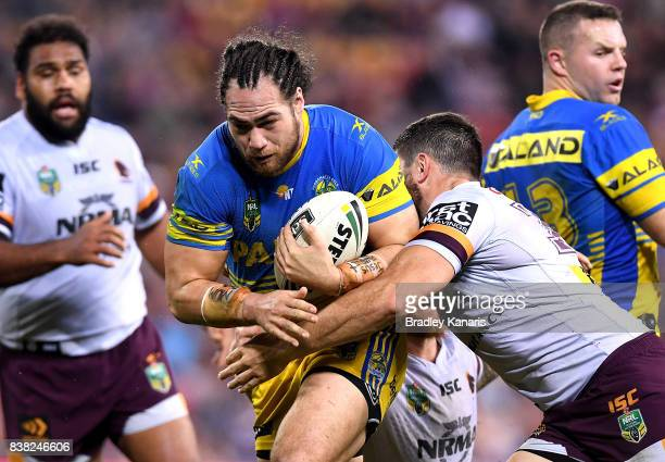 Tepai Moeroa of the Eels takes on the defence during the round 25 NRL match between the Brisbane Broncos and the Parramatta Eels at Suncorp Stadium...
