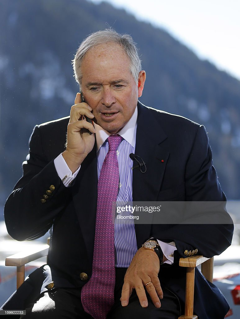 tephen Schwarzman, chairman and chief executive officer of Blackstone Group LP, speaks on his cell phone during a Bloomberg Television interview on the opening day of the World Economic Forum (WEF) in Davos, Switzerland, on Wednesday, Jan. 23, 2013. World leaders, Influential executives, bankers and policy makers attend the 43rd annual meeting of the World Economic Forum in Davos, the five day event runs from Jan. 23-27. Photographer: Simon Dawson/Bloomberg via Getty Images
