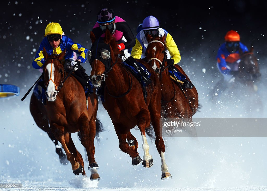 Tepmokea ridden by Shane Kelly (L) and Amazing Beauty ridden by Mirco Demuro (C) lead the field into the final turn during the Grand Prix Guardaval Immobilien race at the White Turf horse racing meeting held on the frozen Lake St Moritz on February 3, 2013 in St Moritz, Switzerland.