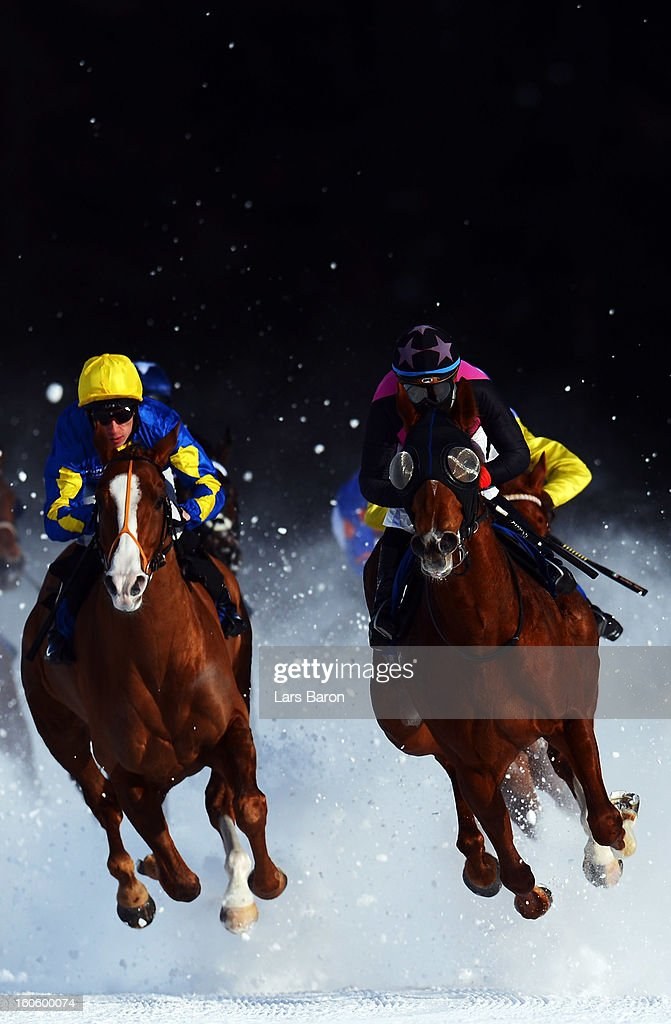 Tepmokea ridden by Shane Kelly (L) and Amazing Beauty ridden by Mirco Demuro (R) lead the field into the final turn during the Grand Prix Guardaval Immobilien race at the White Turf horse racing meeting held on the frozen Lake St Moritz on February 3, 2013 in St Moritz, Switzerland.