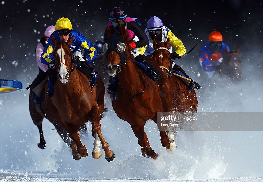 Tepmokea ridden by <a gi-track='captionPersonalityLinkClicked' href=/galleries/search?phrase=Shane+Kelly&family=editorial&specificpeople=240472 ng-click='$event.stopPropagation()'>Shane Kelly</a> (L) leads the field into the final turn during the Grand Prix Guardaval Immobilien race at the White Turf horse racing meeting held on the frozen Lake St Moritz on February 3, 2013 in St Moritz, Switzerland.