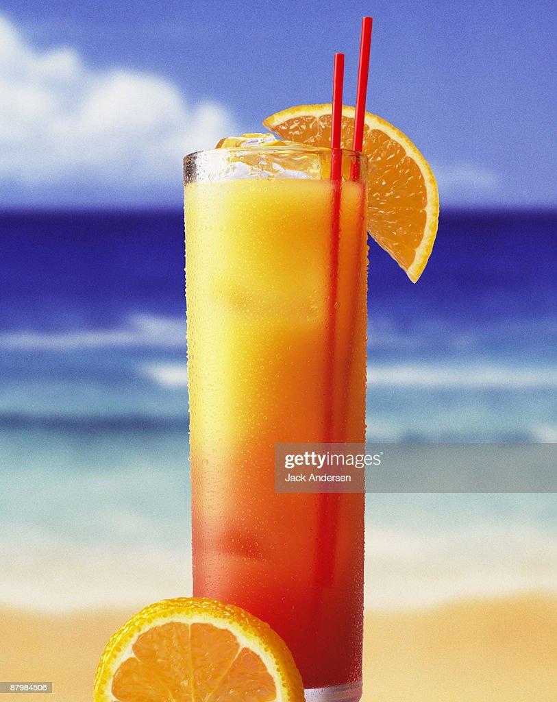 Tequila sunrise on beach : Stock Photo
