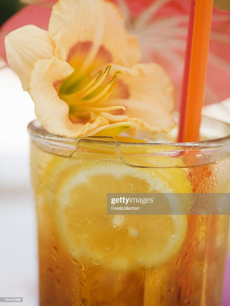 Tequila Sunrise with lemon and flower : Stock Photo