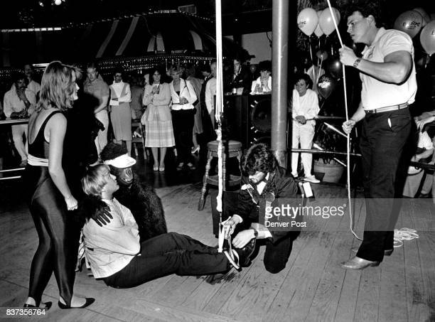 Tequila Willie's Resturant And Bar 2405 S Havana 'magician' Here In This Phot Mark Preston Is Put Into A Straight Jacket And His Feet Tie To A Rope...