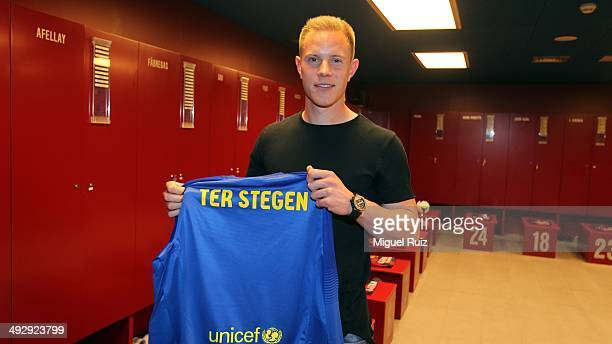 Ter Stegen new FC Barcelona goalkeeper poses for the camera with his shirt after signing his contract with the Club at Camp Nou on May 22 2014 in...