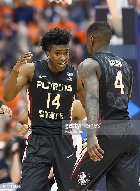 Terance Mann of the Florida State Seminoles celebrates a play with teammate Dwayne Bacon against the Syracuse Orange during the second half at the...