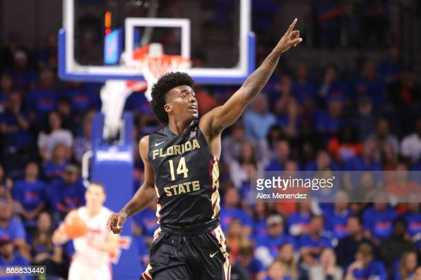 Terance Mann of the Florida State Seminoles points to the crowd after scoring a basket during a NCAA basketball game against the Florida Gators at...