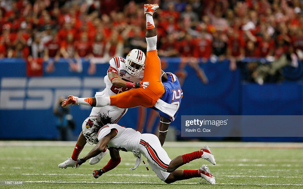Terell Floyd #19 and Hakeem Smith #29 of the Louisville Cardinals break up a pass intended for Omarius Hines #20 of the Florida Gators during the Allstate Sugar Bowl at Mercedes-Benz Superdome on January 2, 2013 in New Orleans, Louisiana.