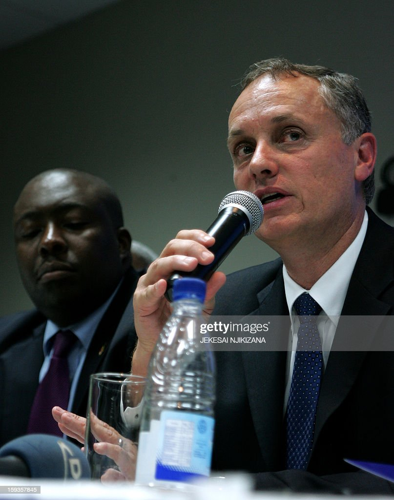 Terence Goodlace (R), the Chief Executive of platinum mining giant Implats, addresses on January 11, 2013 guests at a ceremony in Harare. Impala Platinum, the world's number two producer of platinum on January 11 sealed a deal to sell a 51-percent stake in its Zimbabwean unit Zimplats under a state-imposed black empowerment scheme. AFP PHOTO / Jekesai Njikizana