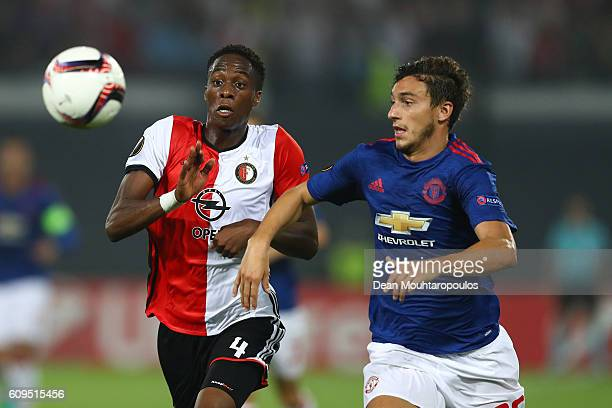 Terence Kongolo of Feyenoord and Matteo Darmian of Manchester United compete for the ball during the UEFA Europa League Group A match between...