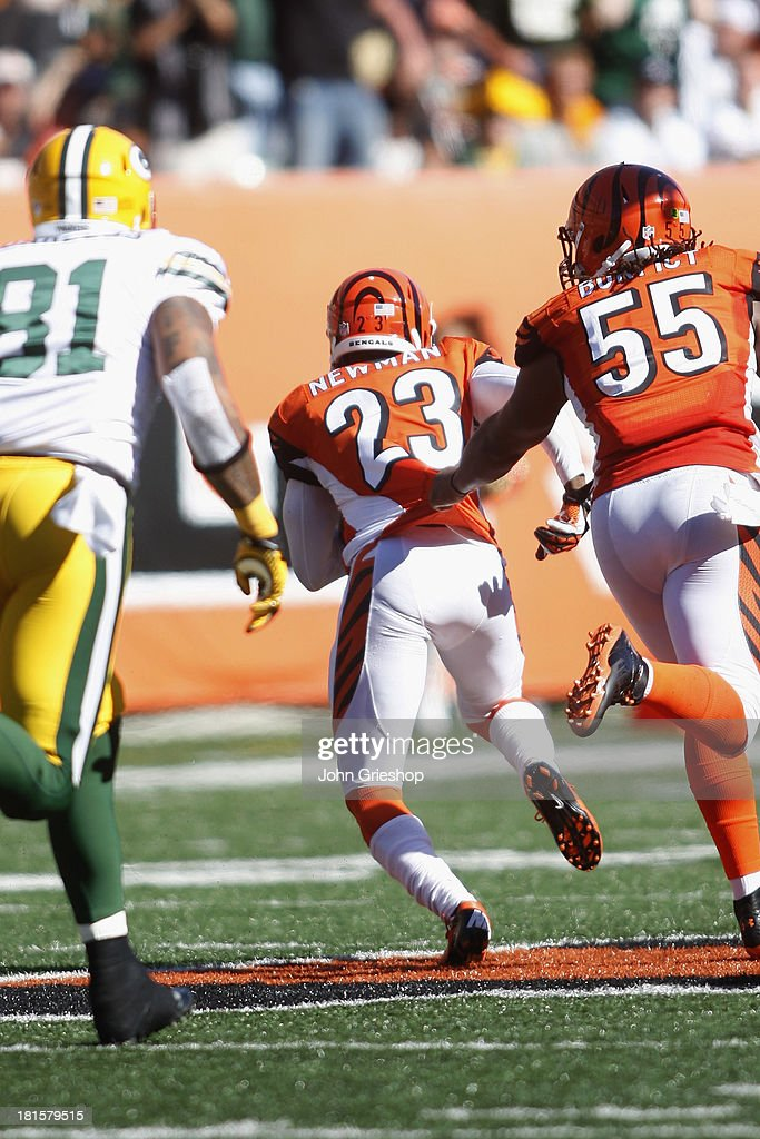 <a gi-track='captionPersonalityLinkClicked' href=/galleries/search?phrase=Terence+Newman&family=editorial&specificpeople=220965 ng-click='$event.stopPropagation()'>Terence Newman</a> #23 of the Cincinnati Bengals returns a fumble for a touchdown during the game against the Green Bay Packers at Paul Brown Stadium on September 22, 2013 in Cincinnati, Ohio. The Bengals defeated the Packers 34-30.