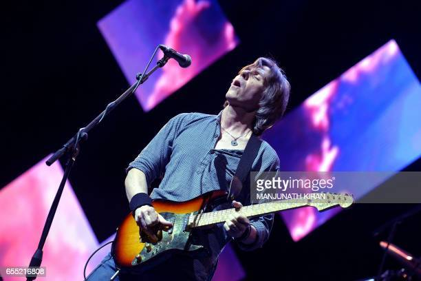 Terence Reis performs with the British band Dire Straits Experience during the 'Play for a Cause' concert in Bangalore on March 19 2017 / AFP PHOTO /...