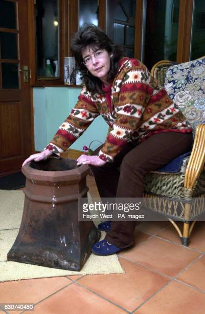 Teresa Christian with a chimney pot in Melton Mowbray after it was removed by firemen when the chimney stack on her house partially collapsed after a...