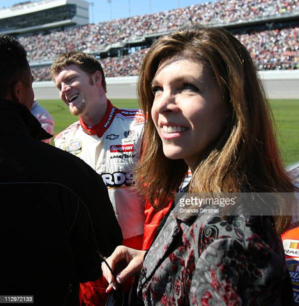 Teresa Earnhardt joins Dale Earnhardt Jr on pit road before the start of the NASCAR Busch Series Orbitz 300 race at Daytona International Speedway in...