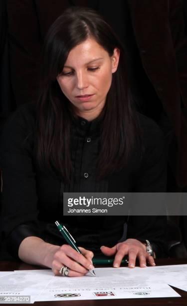 Teresa Enke widow of goalkeeper Robert Enke signs the charter of the Robert Enke Foundation during a DFB meeting on January 15 2010 in Munich Germany