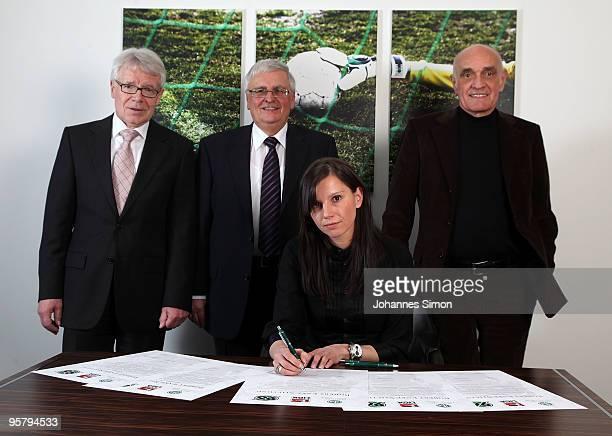 Teresa Enke widow of goalkeeper Robert Enke signs the charter of the Robert Enke Foundation in presence of DFB officials Reinhard Rauball Theo...