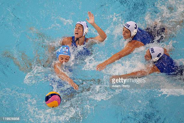 Teresa Frassinetti of Italy is challenged by Kyriaki Liosi Antiopi Melidoni and Alkisti Avramidou of Greece in the Women's Water Polo semi final...