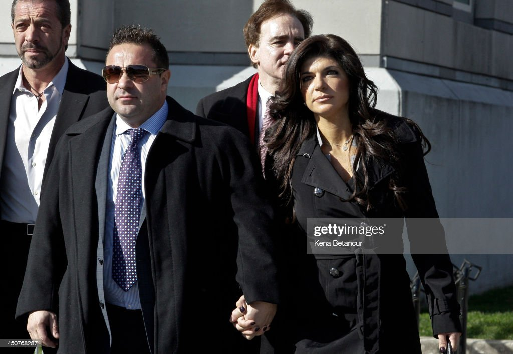<a gi-track='captionPersonalityLinkClicked' href=/galleries/search?phrase=Teresa+Giudice&family=editorial&specificpeople=5912953 ng-click='$event.stopPropagation()'>Teresa Giudice</a> and her husband Giuseppe 'Joe' Giudice (L) leave Newark federal court on November 20, 2013 in Newark, New Jersey. The two of the stars of the Bravo television show 'The Real Housewives of New Jersey' are appearing in court to face additional charges of bank fraud and loan application fraud in addition to original charges of defrauding lenders, illegally obtaining mortgages and other loans as well as allegedly hiding assets and income during a bankruptcy case.