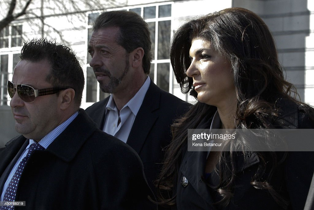 <a gi-track='captionPersonalityLinkClicked' href=/galleries/search?phrase=Teresa+Giudice&family=editorial&specificpeople=5912953 ng-click='$event.stopPropagation()'>Teresa Giudice</a> (R) and her husband Giuseppe 'Joe' Giudice leave Newark federal court on November 20, 2013 in Newark, New Jersey. The two of the stars of the Bravo television show 'The Real Housewives of New Jersey' are appearing in court to face additional charges of bank fraud and loan application fraud in addition to original charges of defrauding lenders, illegally obtaining mortgages and other loans as well as allegedly hiding assets and income during a bankruptcy case.