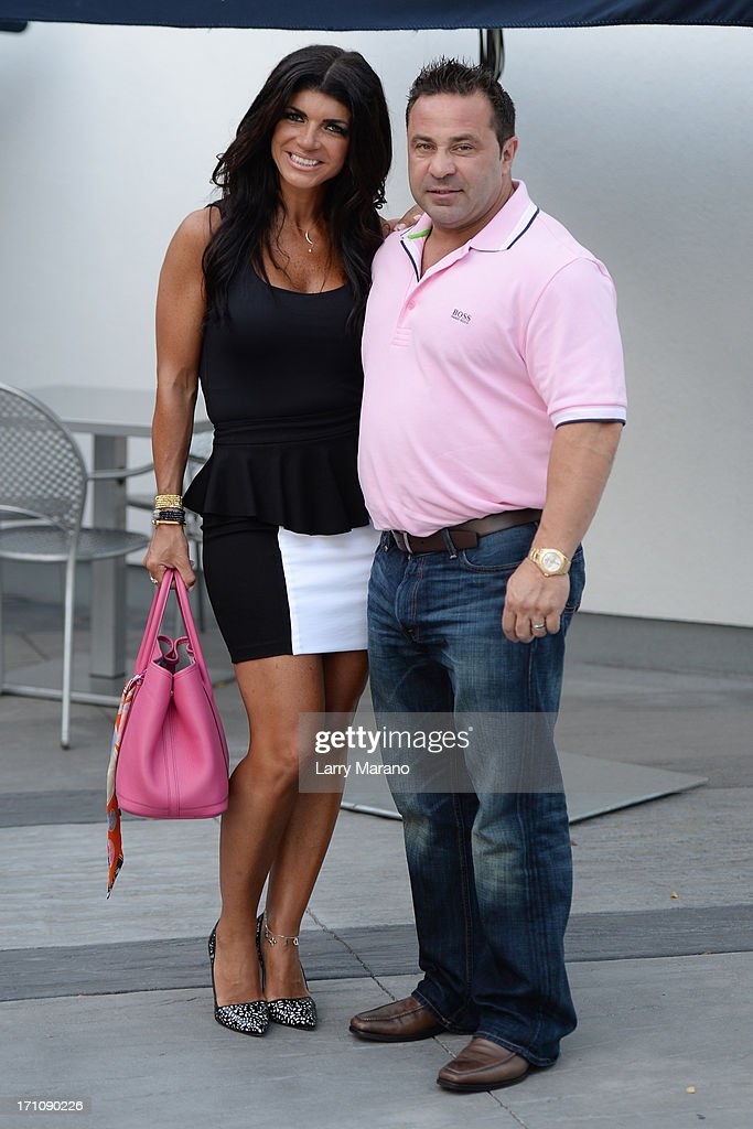 <a gi-track='captionPersonalityLinkClicked' href=/galleries/search?phrase=Teresa+Giudice&family=editorial&specificpeople=5912953 ng-click='$event.stopPropagation()'>Teresa Giudice</a> (L) and her husband <a gi-track='captionPersonalityLinkClicked' href=/galleries/search?phrase=Joe+Giudice&family=editorial&specificpeople=5978109 ng-click='$event.stopPropagation()'>Joe Giudice</a> for her book signing 'Fabulicious!: On The Grill: Teresa's Smoking Hot Backyard Recipes' at Books and Books at Museum of Art on June 21, 2013 in Fort Lauderdale, Florida.