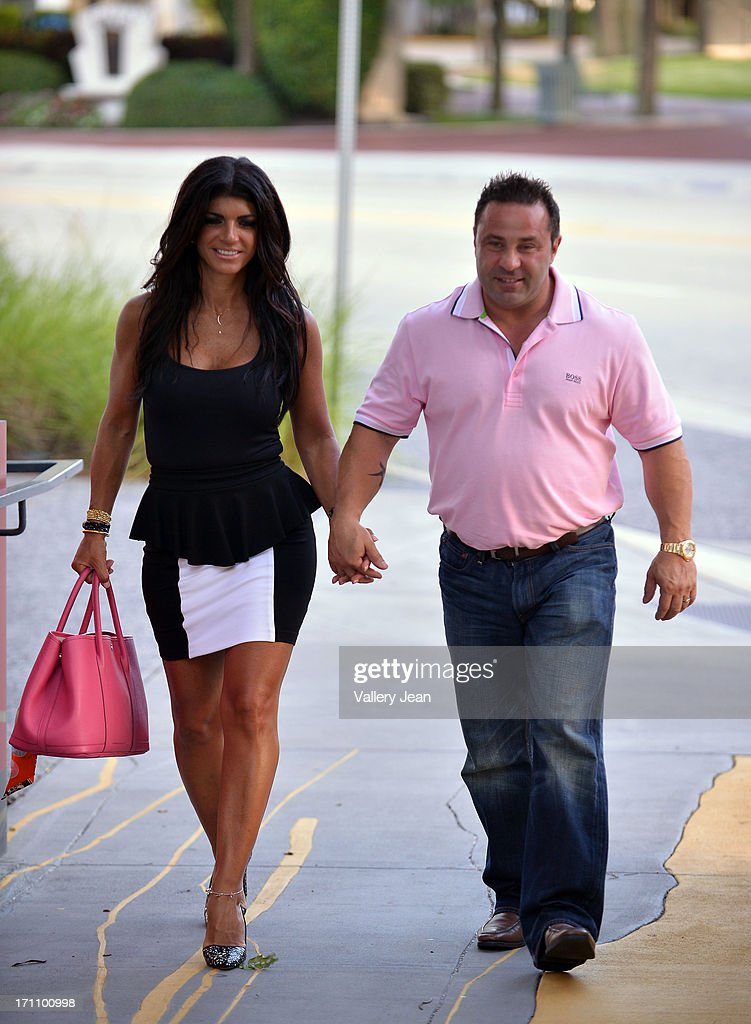 <a gi-track='captionPersonalityLinkClicked' href=/galleries/search?phrase=Teresa+Giudice&family=editorial&specificpeople=5912953 ng-click='$event.stopPropagation()'>Teresa Giudice</a> and her husband <a gi-track='captionPersonalityLinkClicked' href=/galleries/search?phrase=Joe+Giudice&family=editorial&specificpeople=5978109 ng-click='$event.stopPropagation()'>Joe Giudice</a> greets fans and signs copies of 'Fabulicious On The Grill' at Books and Books at Museum of Art on June 21, 2013 in Fort Lauderdale, Florida.