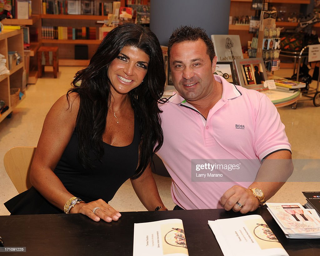 <a gi-track='captionPersonalityLinkClicked' href=/galleries/search?phrase=Teresa+Giudice&family=editorial&specificpeople=5912953 ng-click='$event.stopPropagation()'>Teresa Giudice</a> and her husband Joe greet fans and signs copies of her book 'Fabulicious On The Grill' at Books and Books at Museum of Art on June 21, 2013 in Fort Lauderdale, Florida.