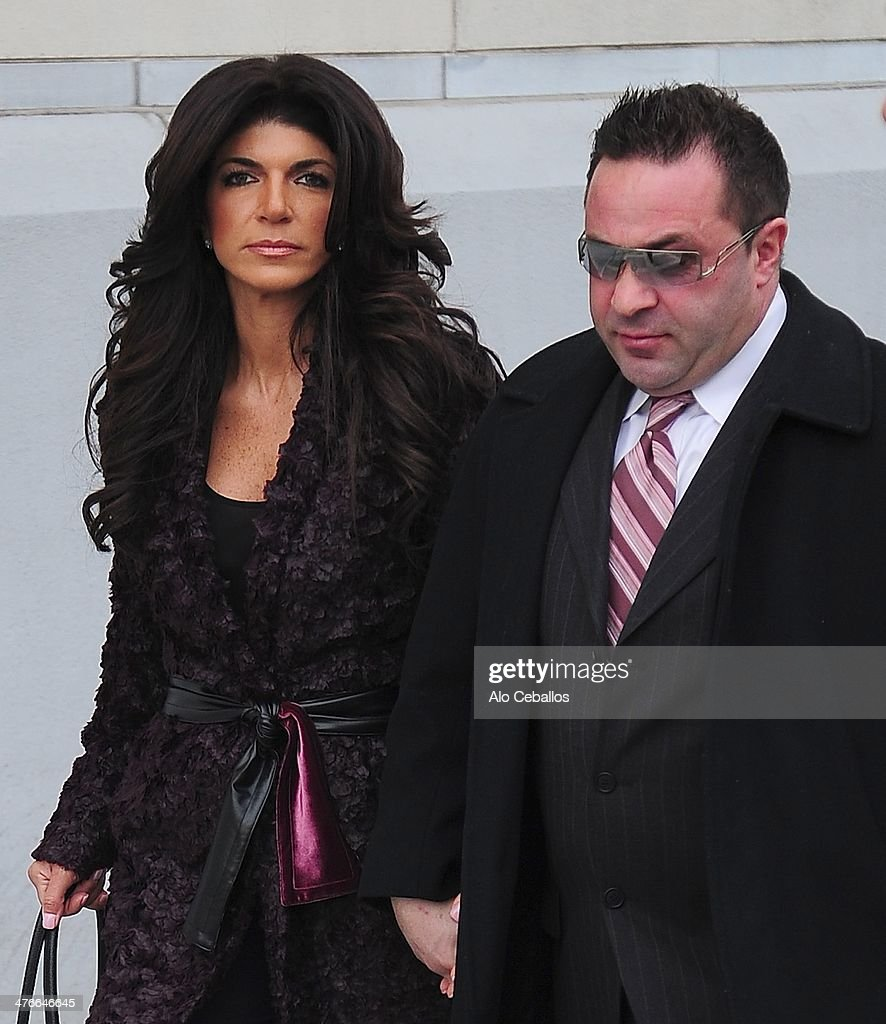 Teresa Giudice and Joe Giudice are seen outside a federal criminal court where they face mortgage and bankruptcy fraud charges on March 4 2014 in...