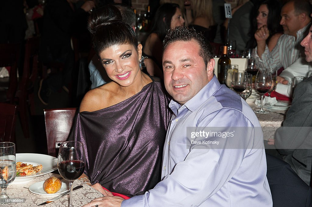 Teresa Giudice and Joe Giudice attend the Posche Fashion show at The Bottagra on December 3, 2012 in Hawthorne, New Jersey.