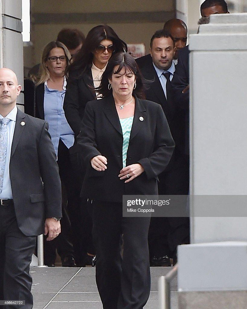 Teresa Giudice and Joe Giudice leave after being sentenced at federal court in Newark on October 2 2014 in Newark New Jersey