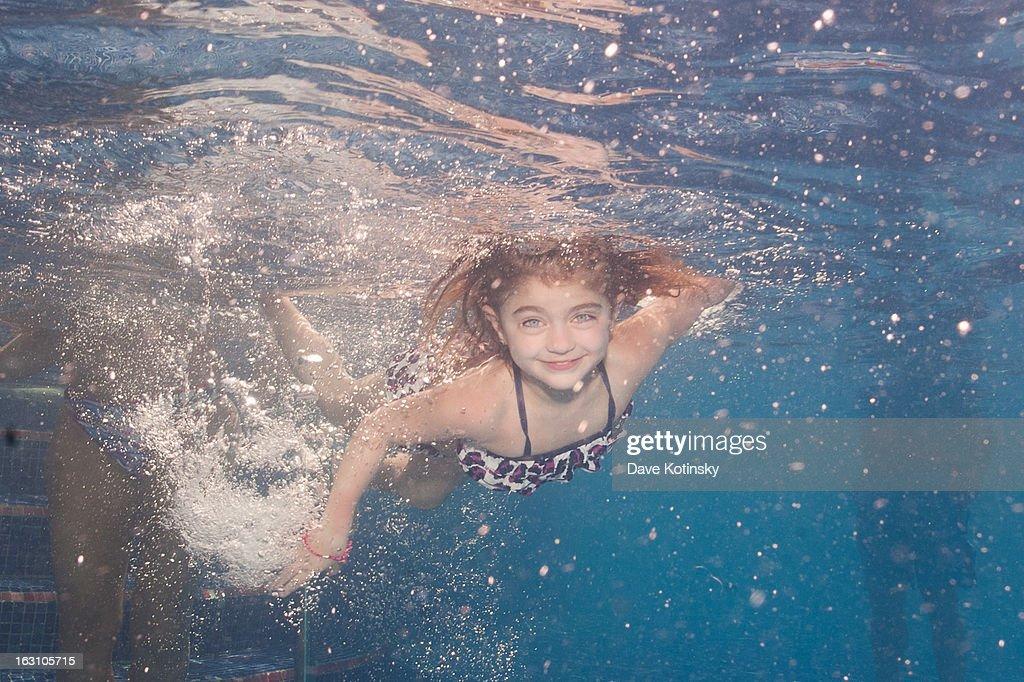Teresa Giudice and Joe Giudice take daughter Audriana Giudice for a swim at Majestic Resort on March 4, 2013 in Punta Cana, Dominican Republic.