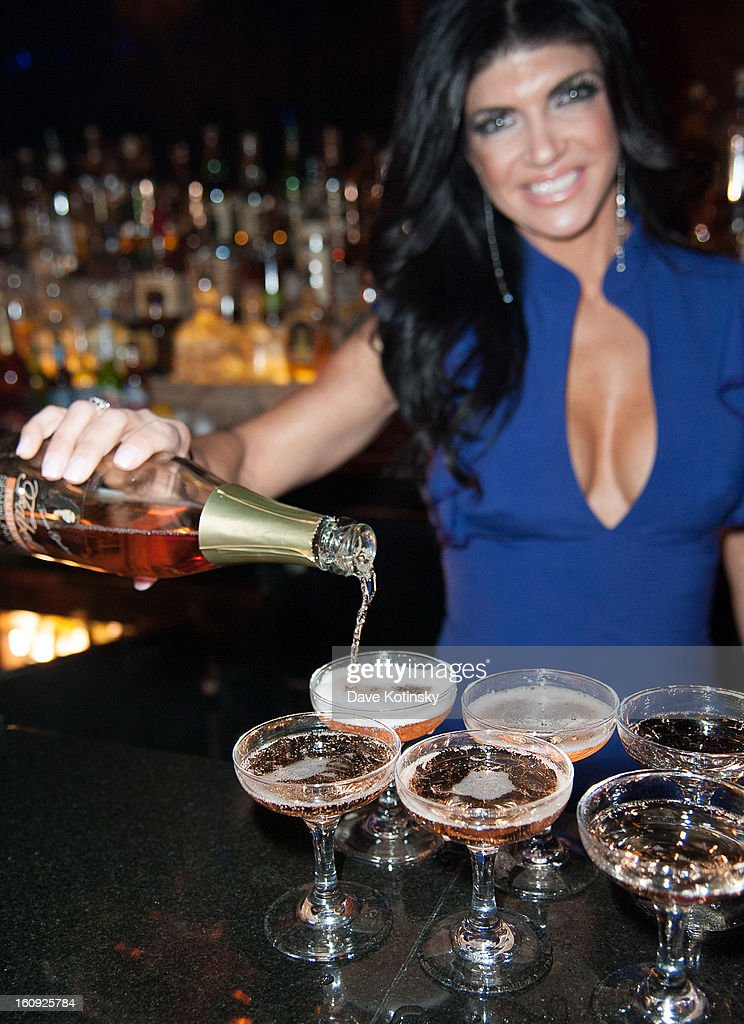Teresa Giudice bartends at Cuffs By Kim D Party during Fall 2013 Fashion Week at Lair on February 7, 2013 in New York City.