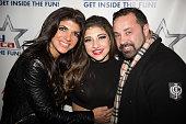 Teresa Giudice Gia Giudice and Joe Giudice pose at iPlay America on December 26 2014 in Freehold New Jersey