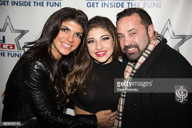 Teresa Giudice Gia Giudice and Joe Giudice pose at iPlay America on December 26 2014 in Freehold New Jersey