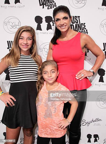 Teresa Giudice Gia Giudice and Milania Giudice attend Just Dance with Boy Meets Girl at the STYLE360 Fashion Pavilion in Chelsea on September 12 2013...
