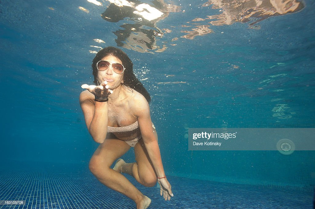 Teresa Giudice goes for a swim at Majestic Resort on March 4, 2013 in Punta Cana, Dominican Republic.