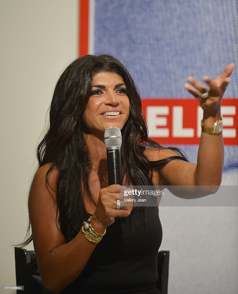 <a gi-track='captionPersonalityLinkClicked' href=/galleries/search?phrase=Teresa+Giudice&family=editorial&specificpeople=5912953 ng-click='$event.stopPropagation()'>Teresa Giudice</a> greets fans and signs copies of 'Fabulicious On The Grill' at Books and Books at Museum of Art on June 21, 2013 in Fort Lauderdale, Florida.