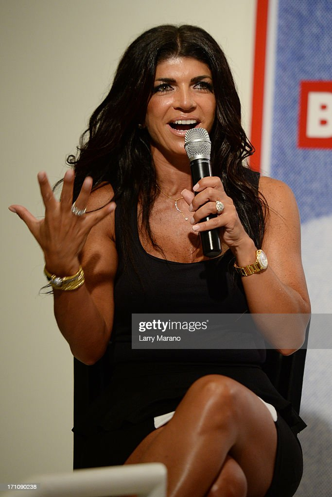 <a gi-track='captionPersonalityLinkClicked' href=/galleries/search?phrase=Teresa+Giudice&family=editorial&specificpeople=5912953 ng-click='$event.stopPropagation()'>Teresa Giudice</a> greets fans and signs copies of her book 'Fabulicious!: On The Grill: Teresa's Smoking Hot Backyard Recipes' at Books and Books at Museum of Art on June 21, 2013 in Fort Lauderdale, Florida.