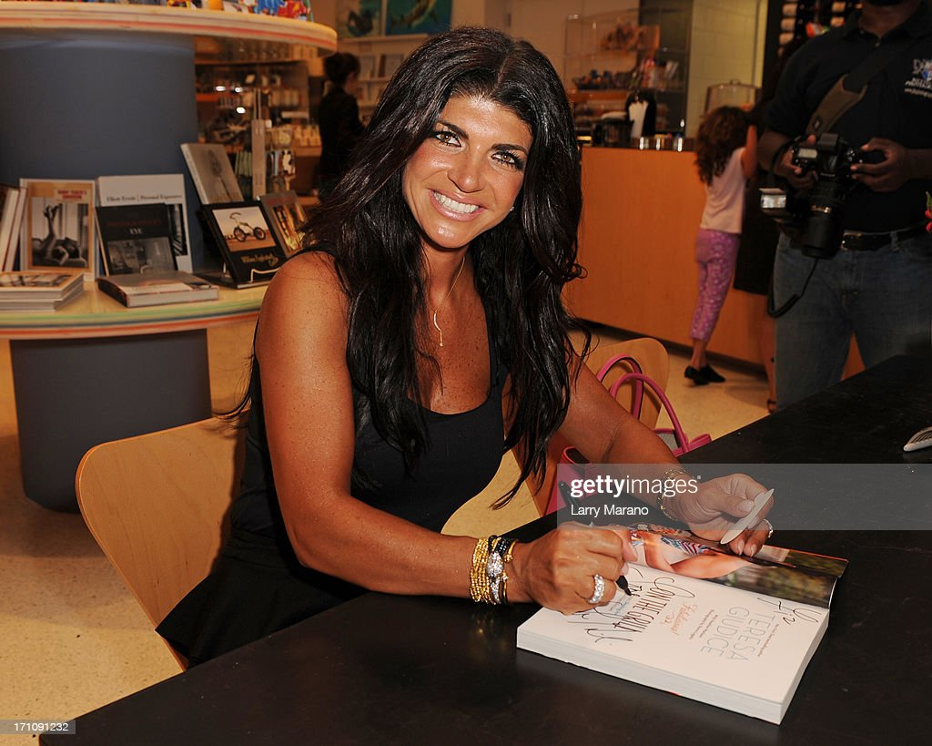 <a gi-track='captionPersonalityLinkClicked' href=/galleries/search?phrase=Teresa+Giudice&family=editorial&specificpeople=5912953 ng-click='$event.stopPropagation()'>Teresa Giudice</a> greets fans and signs copies of her book 'Fabulicious On The Grill' at Books and Books at Museum of Art on June 21, 2013 in Fort Lauderdale, Florida.