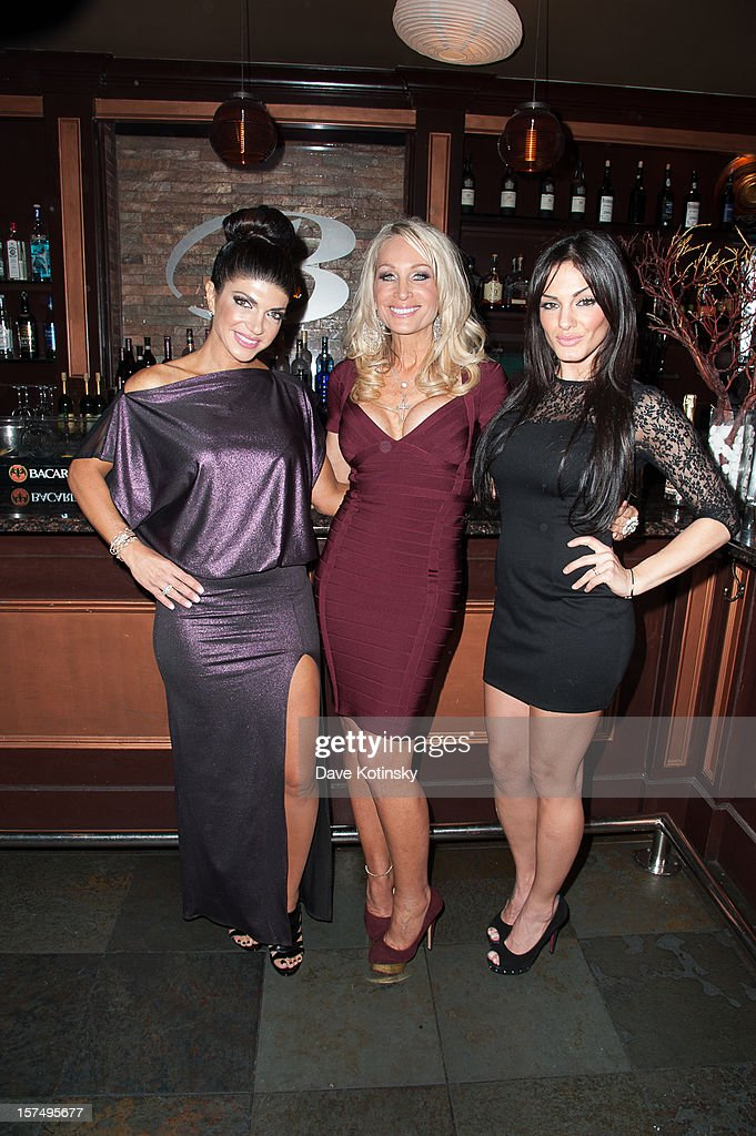 Teresa Giudice, Kim DePaola, and Priscilla DiStasio at the Posche Fashion Show at The Bottagra on December 3, 2012 in Hawthorne, New Jersey.